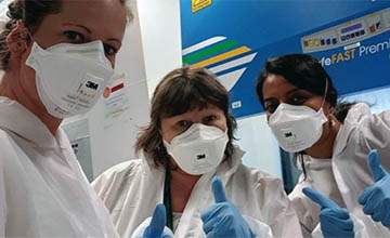 Three of the CIRCO consortium researchers working in the lab.