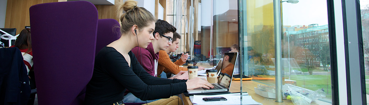 Students at computers in the Alan Gilbert Learning Commons, The University of Manchester