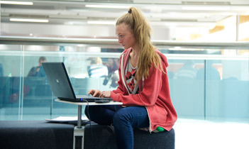Student in the Alan Gilbert Learning Commons at the University of Manchester