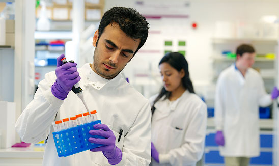 Research student in a lab at The University of Manchester's Faculty of Biology, Medicine and Health