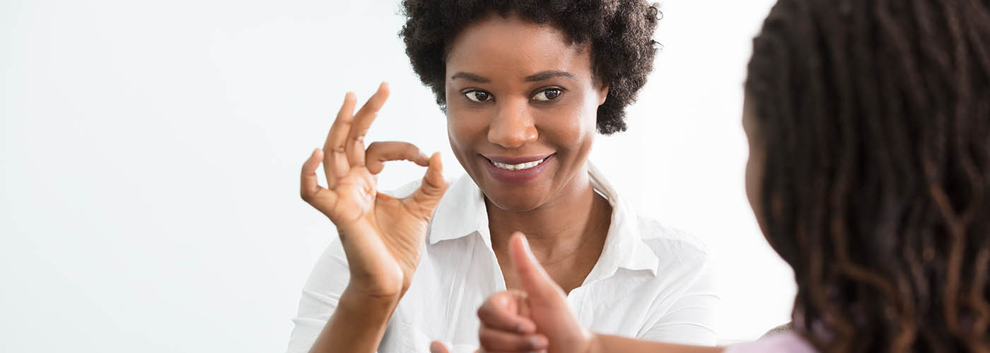 Woman learning sign language