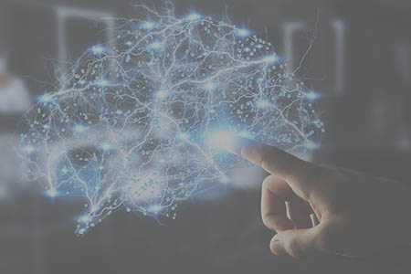 Illustration of a hand touching a representation of a digital brain.