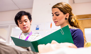 Male and female student in a clinical setting at The University of Manchester